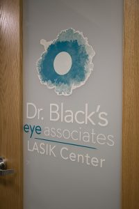 Dr. Black's eye associates LASIK Center logo on door